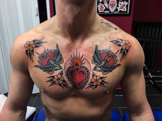 Татуировка swag на груди у парня