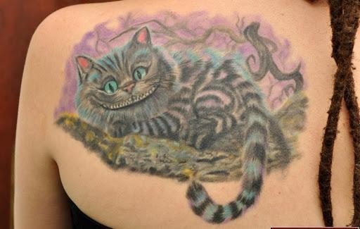 Тату чеширский кот на спине