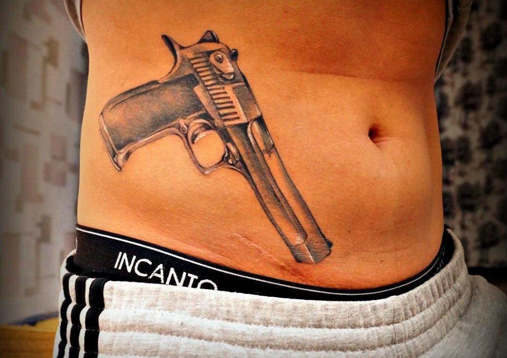 Что означает тату пистолет?